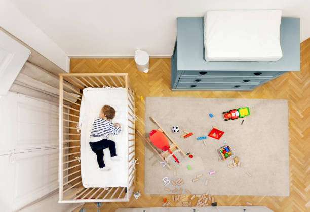 toddler-sleeping-in-his-room-picture-id514378974